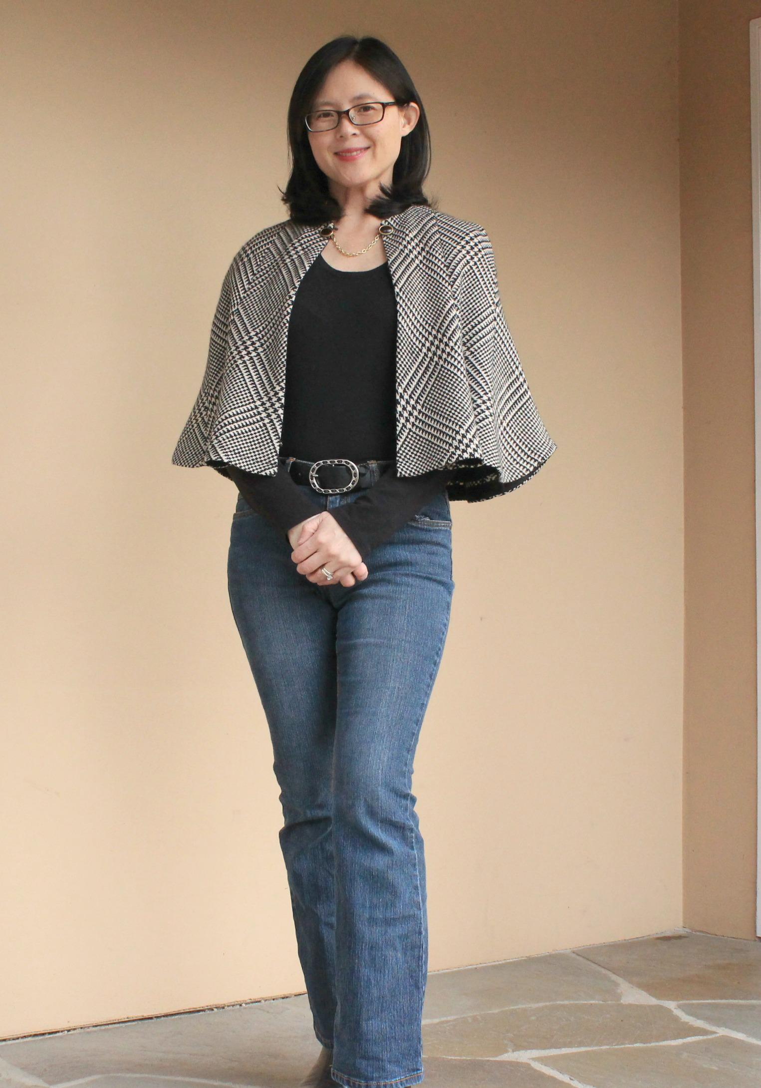 Front view of the skirt to capelet refashion with sweater clip.